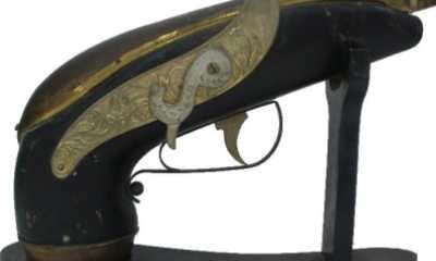bottiglia carillon a forma di pistola